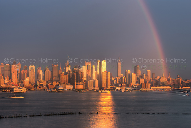 A rainbow appears over the Manhattan skyline in New York City shortly after a summer thunderstorm on Wednesday, August 15, 2012, as the setting sun reflects off the windows of skyscrapers.