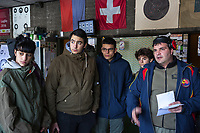 "Switzerland. Canton Ticino. Cureglia is a municipality in the district of Lugano. ""Tiratori del Gaggio"" society. Shooting range. Young shooters' course. The courses, whose organisation is delegated by the Federal Department of Defence, Civil Protection and Sport to the various local shooting societies, are open to young swiss people, boys and girls, from 15 to 20 years old. Girls and boys learn how to handle and fire with the assault rifle SG 550, also called Fass 90, used by the Swiss Army. (Left to right) Sheryl, Matteo, Gabriel, Tommaso listen to the speech by Paolo Grassi, responsible for the security during the course. The SG 550 is an assault rifle manufactured by Swiss Arms AG (formerly Schweizerische Industrie Gesellschaft) of Neuhausen, Switzerland. ""SG"" is an abbreviation for Sturmgewehr, or ""assault rifle"". The rifle is known as the Fass 90 or Stgw 90. An assault rifle is a selective-fire rifle that uses an intermediate cartridge and a detachable magazine. 9.02.2019 © 2019 Didier Ruef"
