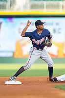 Gwinnett Braves shortstop Elmer Reyes (2) turns a double play against the Charlotte Knights at BB&T Ballpark on August 19, 2014 in Charlotte, North Carolina.  The Braves defeated the Knights 10-5.   (Brian Westerholt/Four Seam Images)