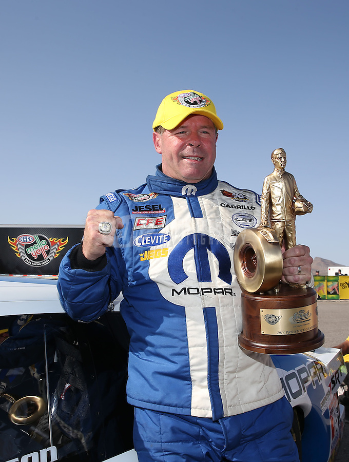 Apr. 7, 2013; Las Vegas, NV, USA: NHRA pro stock driver Allen Johnson celebrates after winning the Summitracing.com Nationals at the Strip at Las Vegas Motor Speedway. Mandatory Credit: Mark J. Rebilas-