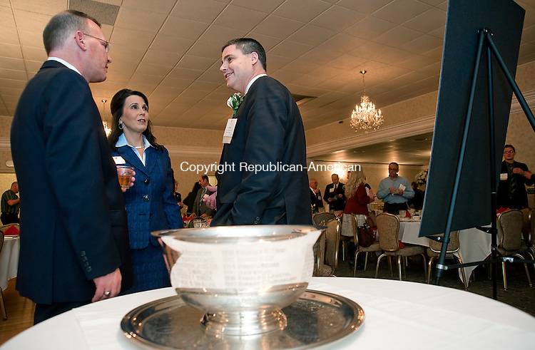 NAUGATUCK, CT-011514JS01-Naugatuck Mayor Robert A. Mezzo, right, recipient of his years Lewis A. Dibble Award, talks with Kevin M. DelGobbo, Senior Advisor to the Mayor of Waterbury, left, and Lynn G. Ward, President and Chief Executive Officer of the Waterbury Regional Chamber, center, during the 92nd Annual Lewis A. Dibble Award and Annual Meeting Wednesday at The Crystal Room in Naugatuck. <br /> Jim Shannon Republican-American