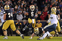 The O-line makes a hole for quarterback Everett Golson in the fourth quarter.