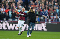 James Collins of West Ham and a West Ham fan on the pitch during West Ham United vs Burnley, Premier League Football at The London Stadium on 10th March 2018