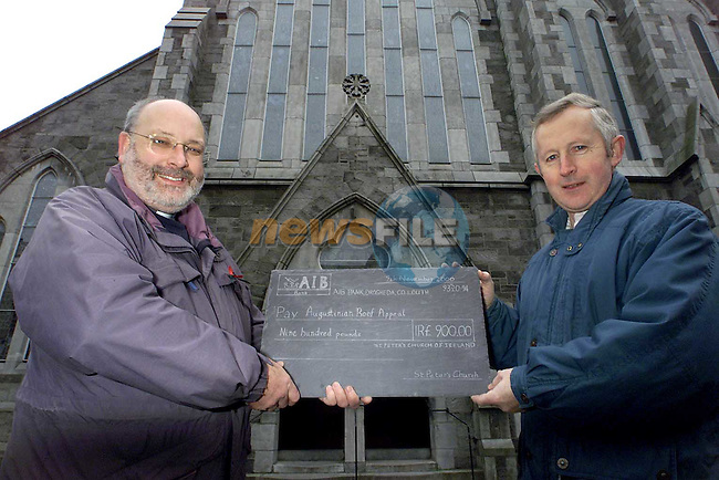Rev. Michael Graham presenting a cheque for the Augustinian Roof appeal to Fr. Flor O'Callaghan..Picture: Paul Mohan/Newsfile