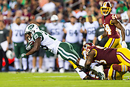 Landover, MD - August 16, 2018: New York Jets running back Bilal Powell (29) is tackled by Washington Redskins defensive end Jonathan Allen (93) during preseason game between the New York Jets and Washington Redskins at FedEx Field in Landover, MD. (Photo by Phillip Peters/Media Images International)
