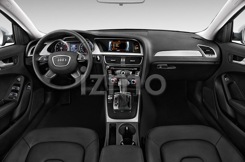 Stock photo of straight dashboard view of 2015-2016 Audi A4 Premium 4 Door Sedan