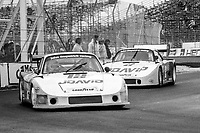 #12 Porsche 935 of Derek Bell and Jochen Mass  leads the #2 Porsche 935 of John Fitzpatrick and David Hobbs on the track during the Budweiser Grand Prix of Miami, Bicentennial Park, Miami, FL, February 27, 1983(Photo by Brian Cleary/bcpix.com)