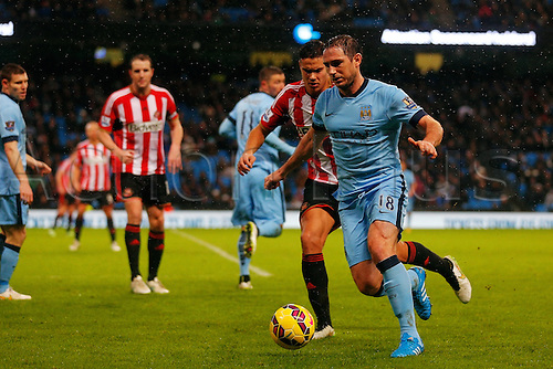01.01.2015.  Manchester, England. Barclays Premier League. Manchester City versus Sunderland. Manchester City midfielder Frank Lampard runs with the ball