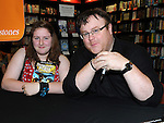 Chloe Gregory pictured with author Derek Landy at his book signing in Waterstones at Scotch Hall. Photo: Colin Bell/pressphotos.ie
