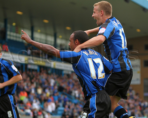 11/09/2010. Danny Spiller (right) jumps in on the celebrations as Chris Palmer (12) salutes the fans following his goal from the penalty spot. Gillingham v Shrewsbury Town. Division 2 match at Priestfield Stadium, Gillingham, Kent, England.