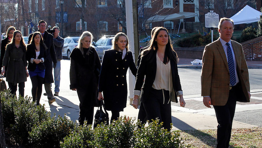CHARLOTTESVILLE, VA - FEBRUARY 13: Family members for George Huguely walk to the Charlottesville Circuit courthouse for the George Huguely trial. Huguely was charged in the May 2010 death of his girlfriend Yeardley Love. She was a member of the Virginia women's lacrosse team. Huguely pleaded not guilty to first-degree murder. (Credit Image: © Andrew Shurtleff