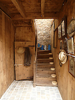 The original entrance hall where the staircase has been left pleasingly askew; the wall behind is the original undressed stone