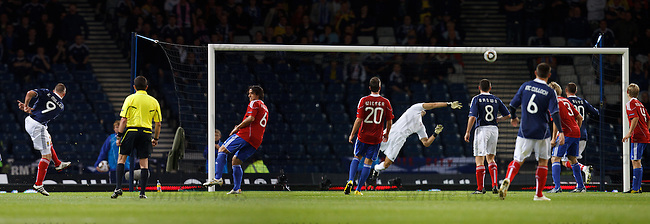 Kenny Miller rifles in Scotland's equaliser over the head of keeper Peter Jehle
