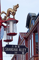 Shanghai Alley street sign with and ornate Chinese streetlights, Chinatown, Vancouver, BC, Canada