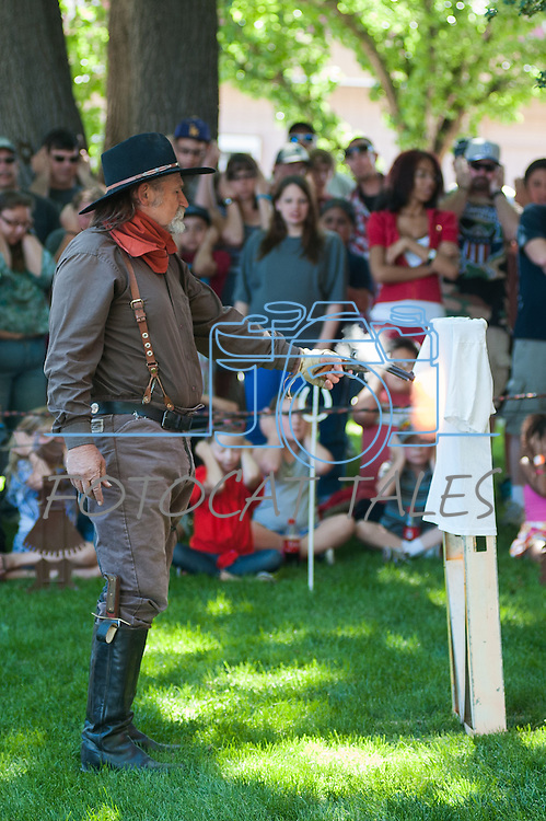 """Larry E. """"Laredo"""" Marcum from Badges, Bandits and Bloomers demos the dangers of a loaded gun during Legends of the West in Carson City, Nev., on Saturday June 22, 2013.<br /> (Photo by Kevin Clifford/Nevada Photo Source)"""