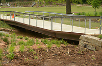 NWA Democrat-Gazette/BEN GOFF @NWABENGOFF<br /> A foot bridge sags Thursday, May 11, 2017 at Lake Atalanta in Rogers after being damaged by flooding in Aprll.