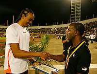 Aires Merritt accepting his award from Donald Quarrie at the Jamaica International Invitational Meet on Saturday, May 2nd. 2009. Photo by Errol Anderson, The Sporting Image.net