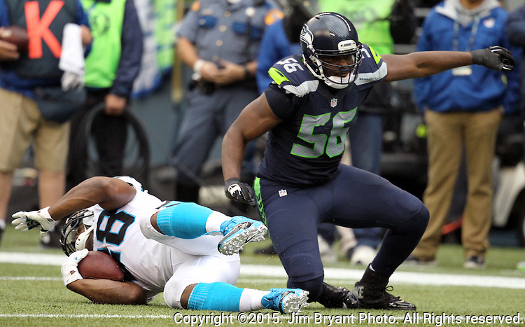 Seattle Seahawks defensive end Cliff Avril (65) drags down Carolina Panthers running back Jonathan Stewart (28)  at CenturyLink Field in Seattle on October 18, 2015. The Panthers came from behind with 32 seconds remaining in the 4th Quarter to beat the Seahawks 27-23.  ©2015 Jim Bryant Photography. All Rights Reserved.