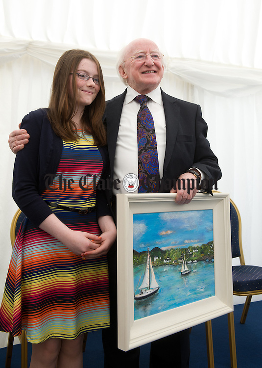 President Michael D Higgins is presented with a painting by local artist Ava Hughes at the official opening of the Watermans Lodge day Care and Respite centre at Ballina. Photograph by John Kelly.