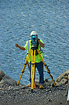 A surveyor takes a reading on work for the Duboistown Bridge.