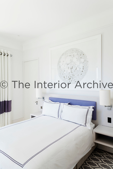 The guest bedroom is of a contemporary design scheme, which emphasises simple architectural forms and a classic blue and white theme.