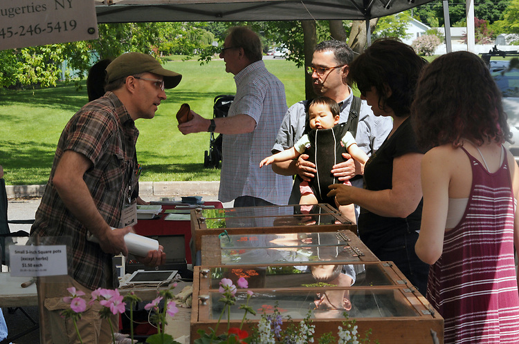 Kevin Dumont, serving customers at the Pura Vida Fisheries Booth at the Opening Day of the 2017 Saugerties Farmer's Market on Saturday, May 27, 2017. Photo by Jim Peppler. Copyright/Jim Peppler-2017.