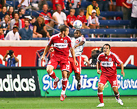 Toronto FC defender Marvell Wynne (16) heads a ball away from Chicago Fire forward Chad Barrett (19) and midfielder Cuauhtemoc Blanco (10).  Chicago Fire defeated Toronto FC by the score of 2-1 at Toyota Park stadium, in Bridgeview, Illinois on Saturday, July 12, 2008.