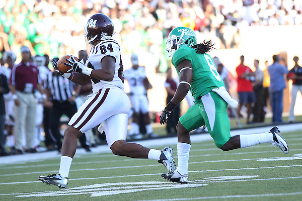 Denton, TX - SEPTEMBER 8: Daniel McKayhan #84 of the Texas Southern Tigers in action against Marcus Trice #8 of the North Texas Mean Green at Apogee Stadium in Denton on September 8, 2012 in Denton, Texas. Photo by: Rick Yeatts