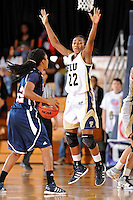 21 January 2012:  FIU guard Jerica Coley (22) jumps in an effort to prevent FAU guard Takia Brooks (22) from passing the ball in the second half as the Florida Atlantic University Owls defeated the FIU Golden Panthers, 50-49, at the U.S. Century Bank Arena in Miami, Florida.