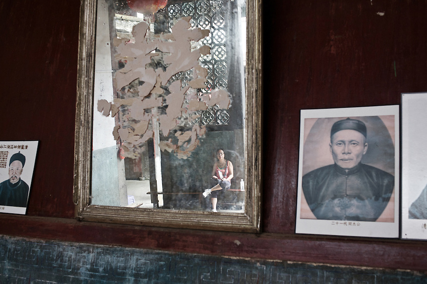 Portraits of the Liao clan displayed in their Tulou, now opened to tourists.