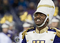 Drum major Nyles Green leads the Husky Band during their halftime performance.