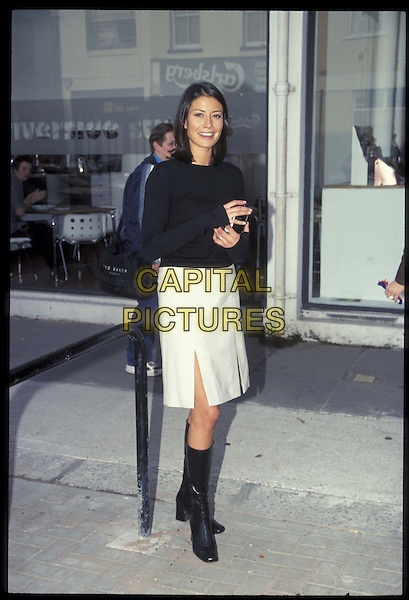 MELANIE SYKES.15 October 1999.Ref: 8974.white skirt, black boots, full length, full-length.*RAW SCAN- photo will be adjusted for publication*.www.capitalpictures.com.sales@capitalpictures.com.©Capital Pictures