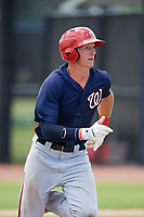 GCL Nationals first baseman Blake Chisolm (17) runs to first base during a game against the GCL Astros on August 6, 2018 at FITTEAM Ballpark of the Palm Beaches in West Palm Beach, Florida.  GCL Astros defeated GCL Nationals 3-0.  (Mike Janes/Four Seam Images)