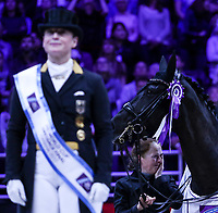 OMAHA, NEBRASKA - APR 1: Isabell Werth's groom, Steffi Wigard, is overcome by emotion after Werth wins the Longines FEI World Cup Dressage Final at the CenturyLink Center on April 1, 2017 in Omaha, Nebraska. (Photo by Taylor Pence/Eclipse Sportswire/Getty Images)