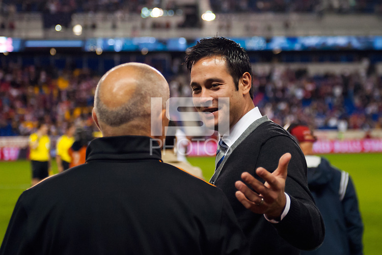 New York Red Bulls head coach Mike Petke talks with Houston Dynamo head coach Dominic Kinnear prior to the match. The Houston Dynamo defeated the New York Red Bulls 2-1 (4-3 on aggregate) in overtime of the second leg of the Major League Soccer (MLS) Eastern Conference Semifinals at Red Bull Arena in Harrison, NJ, on November 6, 2013.