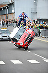 russ swift driving a mini on two wheels and Tim Schieff  World Freerunning Champion at the  Olympic Torch Relay at MINI Plant Oxford on Monday 9th July 2012  Picture By: Brian Jordan / Retna Pictures.. ..-..