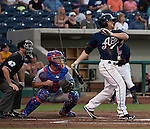Reno Aces Tyler Kuhn swings against the Round Rock Express during their game on Thursday night August 16, 2012 at Aces Ballpark in Reno NV.