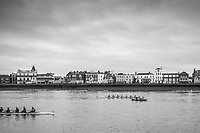 London. United Kingdom,  No.2. Cambridge University Women's Boat Club, move past an umpire's tin fish launch, passing Barnes during the 2018 Women's Head of the River Race.  location Barnes Bridge, Championship Course, Putney to Mortlake. River Thames, <br />