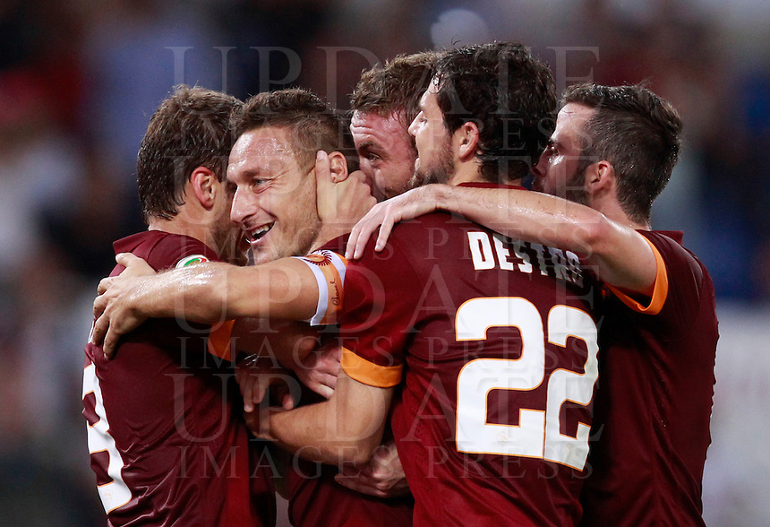 Calcio, Serie A: Roma vs ChievoVerona. Roma, stadio Olimpico, 18 ottobre 2014.<br /> Roma's Francesco Totti, second from left, celebrates with teammates, from left, Adem Ljajic, Daniele De Rossi, Mattia Destro and Miralem Pjanic after scoring on a penalty kick during the Italian Serie A football match between Roma and ChievoVerona at Rome's Olympic stadium, 18 October 2014.<br /> UPDATE IMAGES PRESS/Isabella Bonotto
