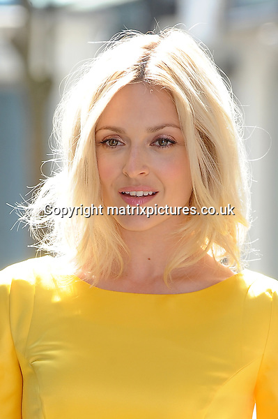 NON EXCLUSIVE PICTURE: PAUL TREADWAY / MATRIXPICTURES.CO.UK<br /> PLEASE CREDIT ALL USES<br /> <br /> WORLD RIGHTS<br /> <br /> English television and radio presenter, Fearne Cotton attends a photocall to promote her A/W14 fashion collection for Very.co.uk,  on Dean Street in London.<br /> <br /> JULY 30th 2014<br /> <br /> REF: PTY 143516