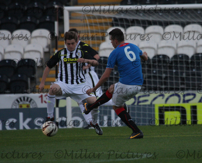 Lewis McLear tries to intercept the pass of Kyle McAusland in the St Mirren v Rangers Scottish Professional Football League Under 20 match played at St Mirren Park, Paisley on 10.9.13.