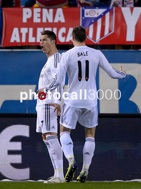 Real Madrid's Portuguese forward Cristiano Ronaldo celebrates after scoring during the Spanish Copa del Rey (King's Cup) semifinal second-leg football match Club Atletico de Madrid vs Real Madrid CF at the Santiago Bernabeu stadium in Madrid on February 11, 2014.   AFP PHOTO/ DANI POZO