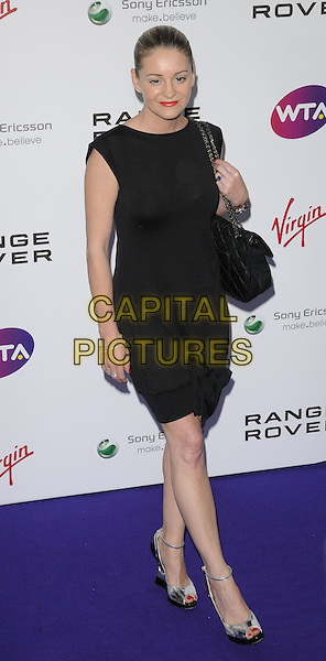 Nicola Stapleton.The WTA Tour Pre-Wimbledon Party at The Roof Gardens, Kensington, London, England, UK..16th June 2011.full length black dress sleeveless bag purse .CAP/CAN.©Can Nguyen/Capital Pictures.