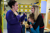 NWA Democrat-Gazette/CHARLIE KAIJO Summer Enriquez of Rogers hugs Meah Murillo, 8, (from right) as they talk to Cassie Flowers of Rogers, the girl's aunt and teacher at the center, Saturday, November 3, 2018 at the Helen Walton Children&Otilde;s Enrichment Center in Bentonville.<br />
