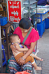 Vender With Child Near Gyee Zai Market