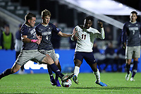 CARY, NC - DECEMBER 15: Foster McCune #22 and Sean O'Hearn #4 of Georgetown University challenge for the ball with Irakoze Donasiyano #11 of University of Virginia during a game between Georgetown and Virginia at Sahlen's Stadium at WakeMed Soccer Park on December 15, 2019 in Cary, North Carolina.
