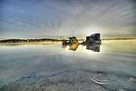 Fall sunrise behind a houseboat in Yellowknife Bay
