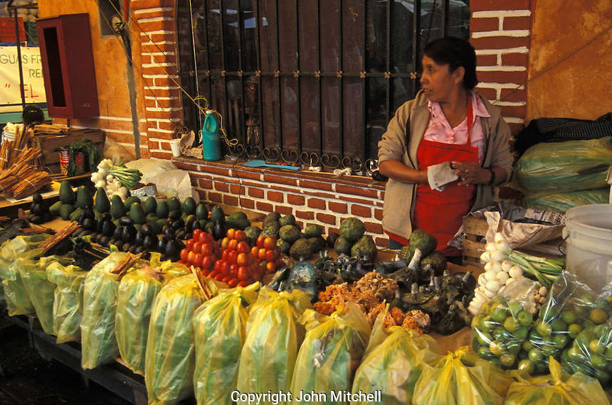 Woman selling produce at the market in Tepoztlan, Morelos, Mexico. Tepoztlan has been designated a pueblo magico or magical town.