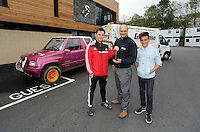 """Pictured L-R: Team physiotherapist Richie Buchanan hands over the keys to Leigh Evans for the Suzuki Samurai at the Landore Training Ground. Saturday 10 May 2014<br /> Re: Leigh Evans of Leigh Enterprise Tyres is the new owner of """"the pink Ferrari"""", an old Suzuki Samurai 4x4 car used by Swansea City FC players during the last season."""
