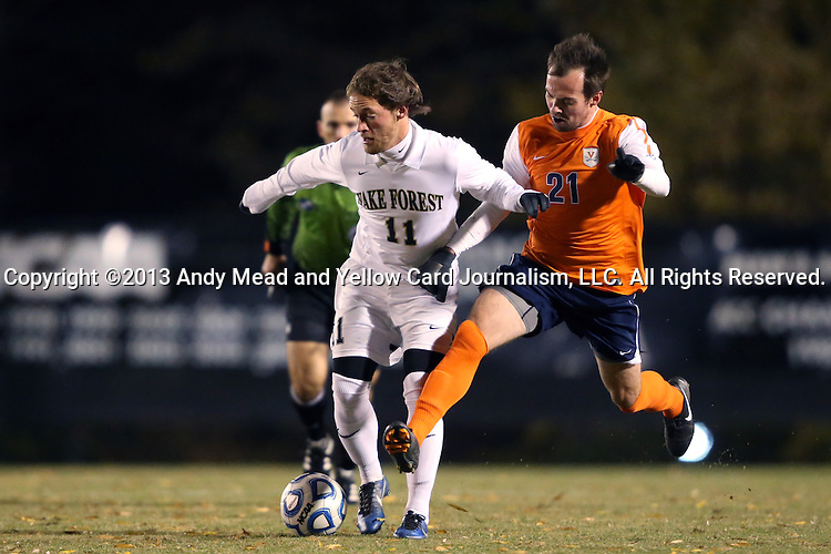 12 November 2013: Wake Forest's Luca Gimenez (BRA) (11) and Virginia's Ryan Zinkhan (21). The Wake Forest University Demon Deacons hosted the University of Virginia Cavaliers at Spry Stadium in Winston-Salem, North Carolina in a 2013 NCAA Division I Men's Soccer match and the quarterfinals of the Atlantic Coast Conference tournament. Virginia won the game 1-0 in overtime.